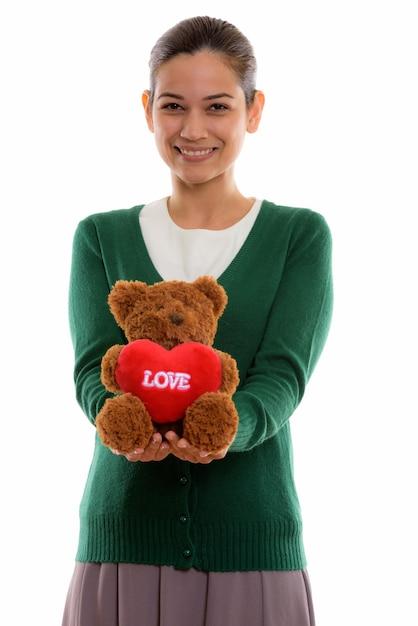 Szczęśliwa Młoda Piękna Kobieta Uśmiecha Się Trzymając Misia Premium Zdjęcia
