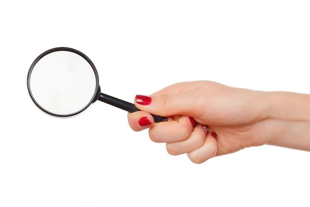Szkło Powiększające W Ręce Kobiety Na Białym Tle Premium Zdjęcia