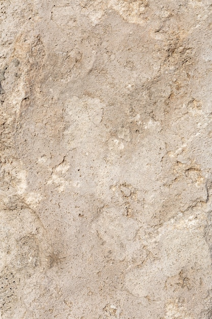 Szorstka, Nierówna Tekstura Brązowej ściany Betonowej Z Bliska Premium Zdjęcia