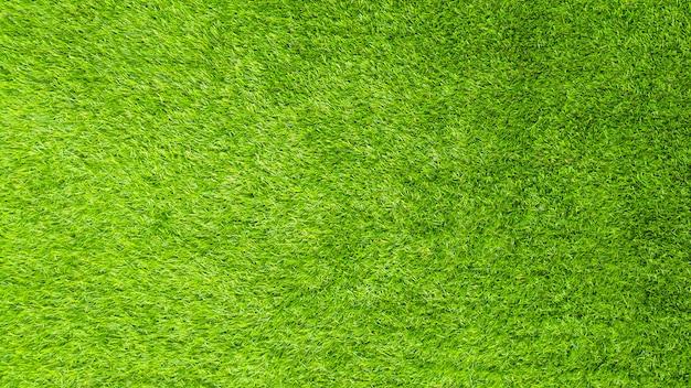 Sztuczna zielona trawa wzór tekstury. Premium Zdjęcia
