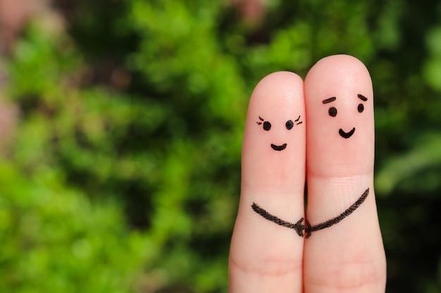 Sztuka palec szczęśliwej pary. szczęśliwa para trzymając się za ręce. Premium Zdjęcia
