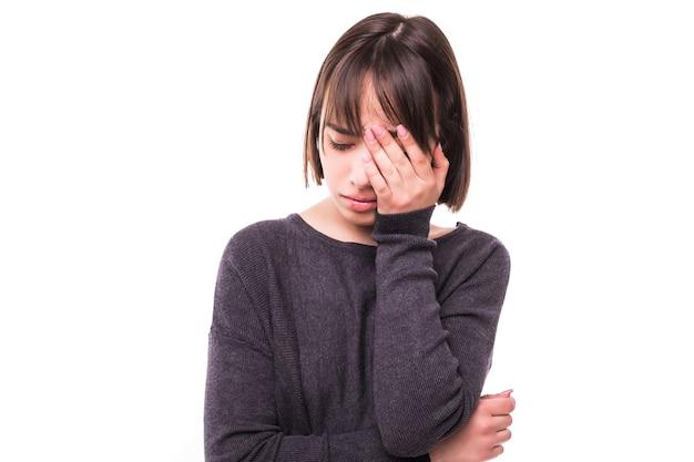Teen Kobieta Z Bólem Głowy, Trzymając Ją Za Rękę Do Głowy, Odizolowane Darmowe Zdjęcia