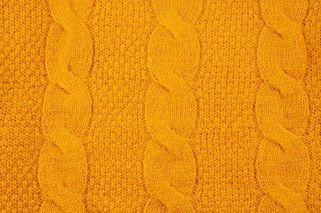 Tekstura Pomarańczowy Wełniany Sweter Z Dzianiny Premium Zdjęcia