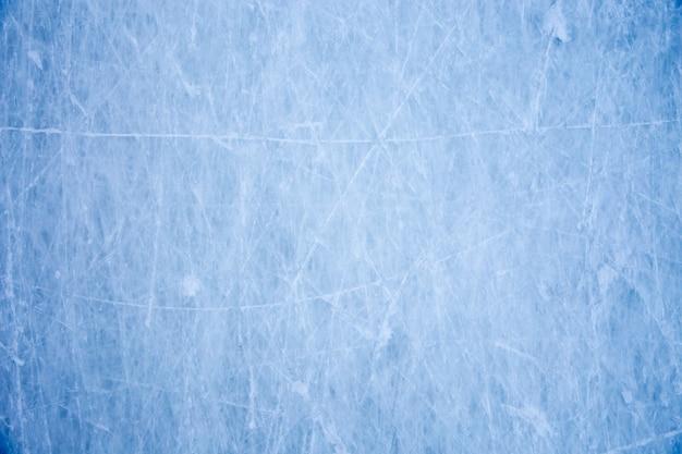 Tekstura powierzchni lodu niebieski z zadrapaniami skate Premium Zdjęcia