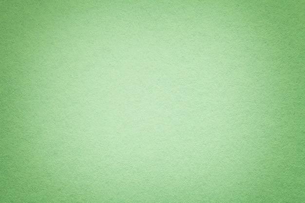 Tekstura Stary Zielonego Papieru Tło, Zbliżenie. Struktura Gęstego Jasnego Kartonu Oliwkowego. Premium Zdjęcia