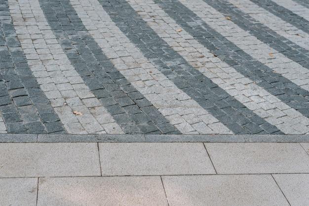 Tekstura Szarego Kamienia Kostki Brukowej W Zbliżeniu Premium Zdjęcia