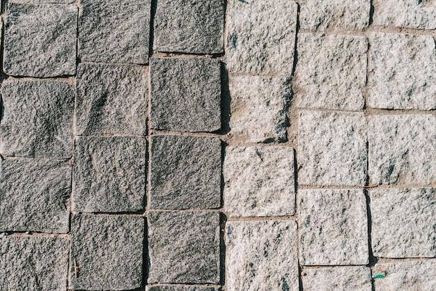 Tekstura Szarej Kamiennej Kostki Brukowej Premium Zdjęcia