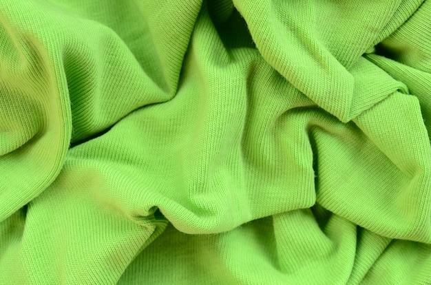 Tekstura tkaniny jest jasnozielona. materiał do produkcji koszul i bluzek Premium Zdjęcia