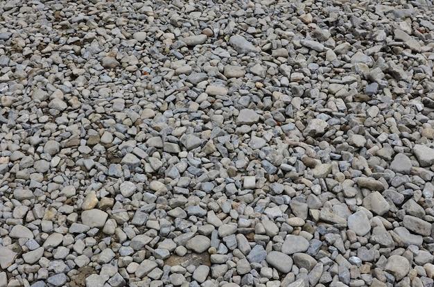 Tekstura wielu zgniecionych kamieni. kruszony kamień jest solidnym materiałem podstawowym do fundamentów Premium Zdjęcia