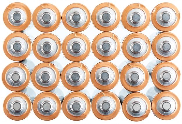 Teksturowane baterie elektryczne aa (aaa). widok bieguna dodatniego (+ -). Premium Zdjęcia