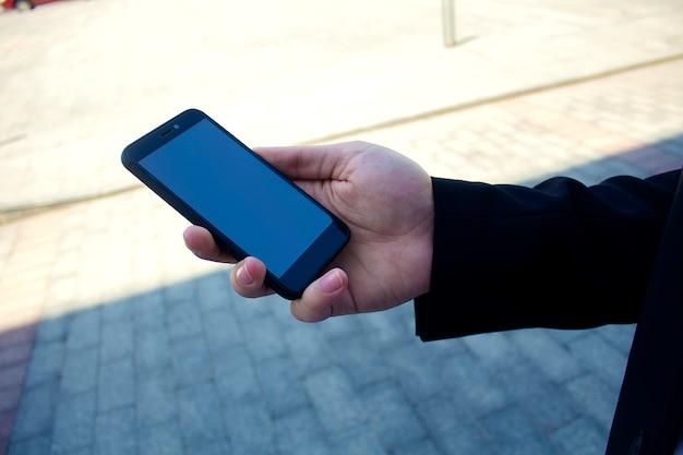 Telefon komórkowy w ręku Premium Zdjęcia