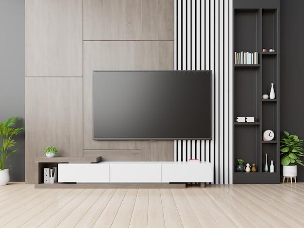 Telewizor Na ścianie Ma Szafkę W Nowoczesnym Pustym Pokoju Z Drewnianą ścianą. Premium Zdjęcia