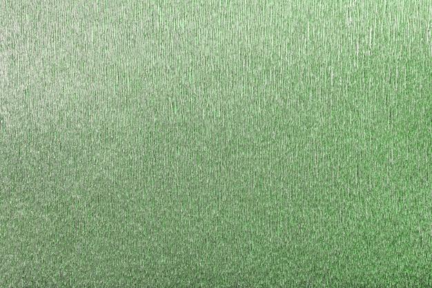 Textural zielony tło falisty gofrujący papier, zbliżenie. Premium Zdjęcia
