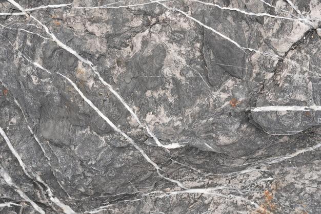Tło i tekstura czerń kamień i biała linia Premium Zdjęcia