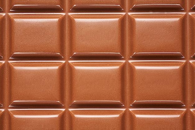 Tło z czekolady z bliska. Premium Zdjęcia