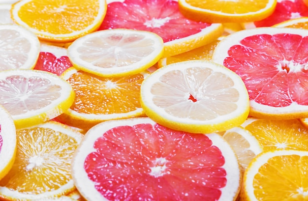 Tło Z Owoców Cytrusowych Plasterków świeżych Owoców Premium Zdjęcia
