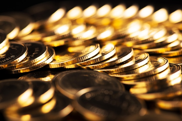 Tło Złote Monety. Premium Zdjęcia