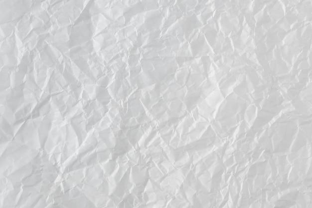 Tło Zmięty Papier. Abstrakcjonistyczna Tekstura, Powierzchnia Z Marszczącym Skutkiem. Premium Zdjęcia