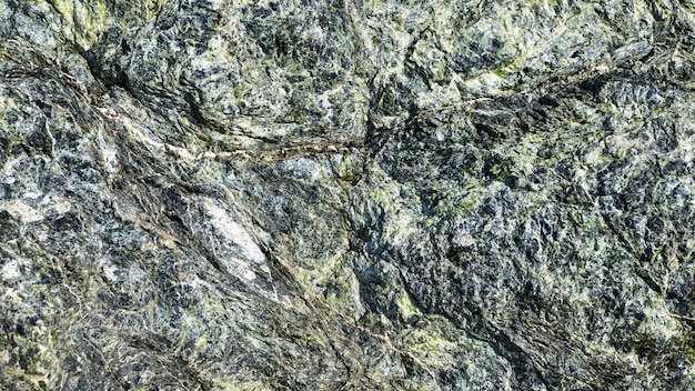 Tłoczona Powierzchnia Z Teksturowanym Kamiennym Tłem. Teksturowana Powierzchnia Naturalnej Skały. Faktura Premium Zdjęcia