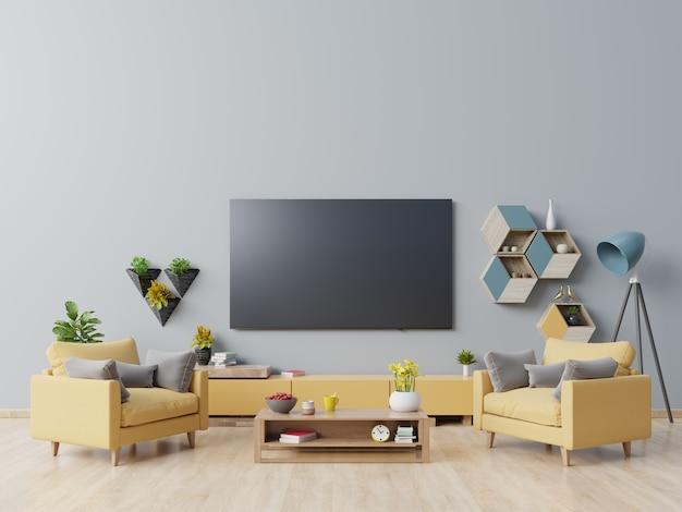 Tv na szafce w nowoczesnym salonie z żółtym fotelem na ciemnoniebieskiej ścianie. Premium Zdjęcia