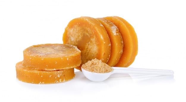 Twarda Melasa Z Trzciny Cukrowej Lub Jaggery I Cukier W łyżce Premium Zdjęcia