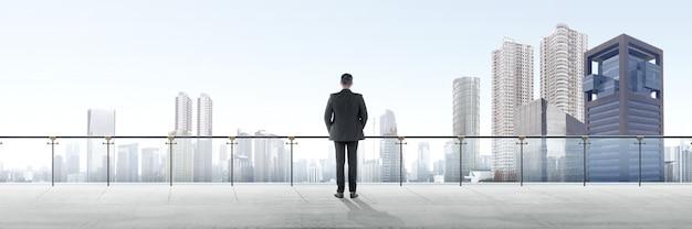 Tylni Widok Azjatykcia Biznesmen Pozycja Na Nowożytnym Tarasie I Patrzeć Widok Premium Zdjęcia
