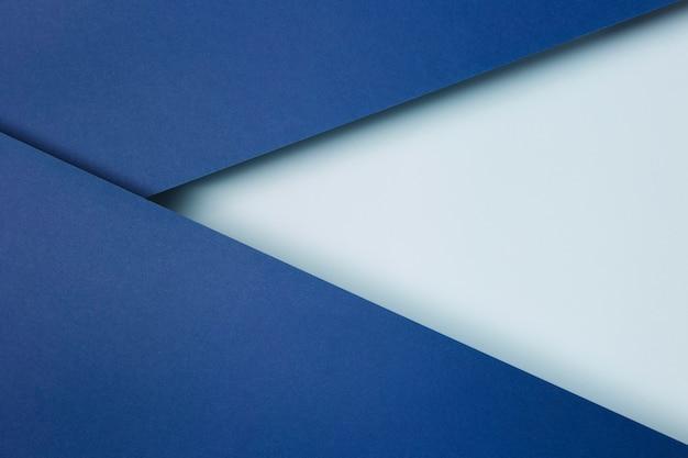 Układ Niebieskie Tło Arkuszy Papieru Premium Zdjęcia
