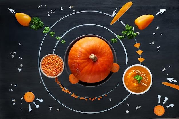 Układ Słoneczny Z Dyni Kosmicznej Z Pomarańczowymi Warzywami, Płaskie Pojęcie świeżej Zdrowej żywności Premium Zdjęcia
