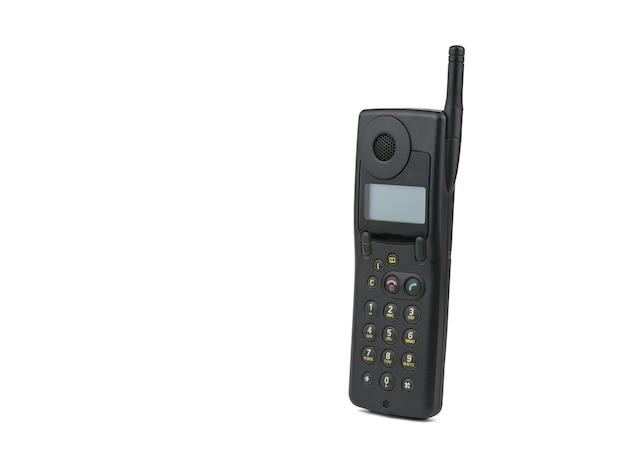 Vintage Czarny Telefon Komórkowy Na Białym Tle. Retro środki Komunikacji. Technologia Z Przeszłości. Premium Zdjęcia