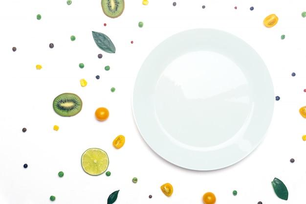 Wegańskie Detoksykacyjne Warzywa I Owoce Z Talerzem Premium Zdjęcia