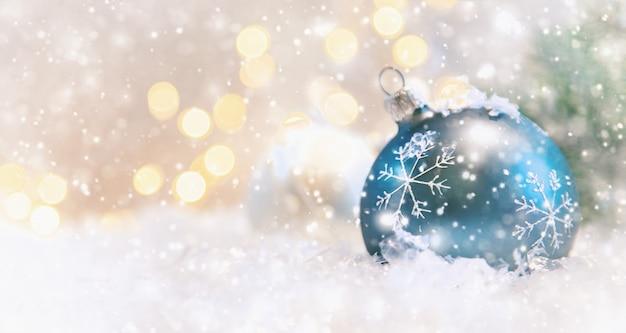 Wesołych świąt i szczęśliwego nowego roku, tło wakacje kartkę z życzeniami. Premium Zdjęcia