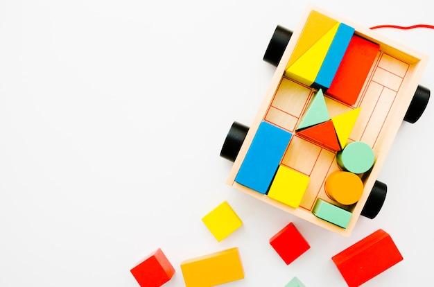 Widok z góry drewniane zabawki dla dzieci z miejsca kopiowania Darmowe Zdjęcia