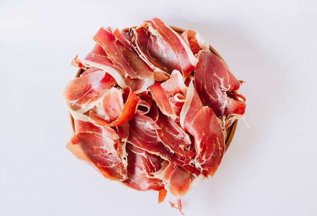 Widok Z Góry Jamon. Pyszna Szynka Typowa Dla Hiszpanii. We Włoszech Znany Jest Jako Prosciutto. Premium Zdjęcia