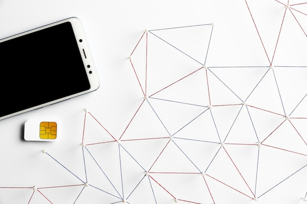 Widok Z Góry Sieci Komunikacji Internetowej Ze Smartfonem I Kartą Sim Darmowe Zdjęcia