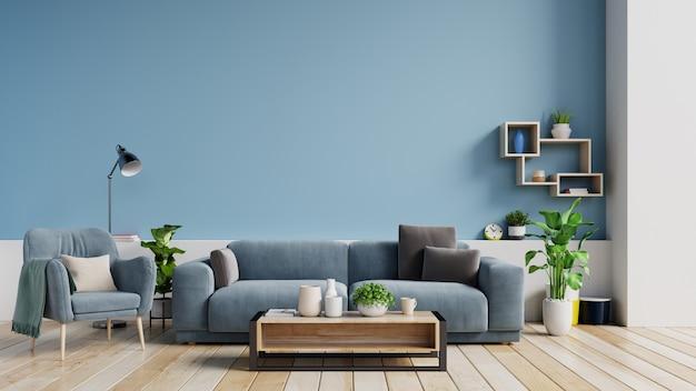 Wnętrze jasny salon z poduszkami na kanapie i fotel, rośliny i lampa na pustym niebieskim tle ściany. Premium Zdjęcia