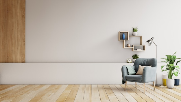 Wnętrze ma fotel na pustej białej ścianie. Premium Zdjęcia