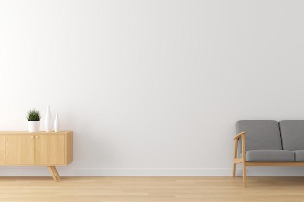 Wnętrze salonu biała ściana, drewniana podłoga i szara konfiguracja sofy do reklamy z pustą przestrzenią na tekst. Premium Zdjęcia