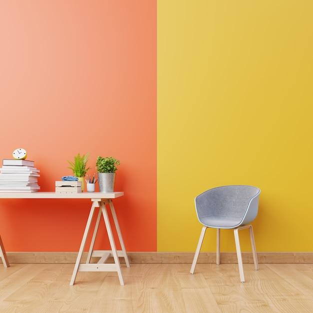 Wnętrze salonu z pomarańczowymi i żółtymi ścianami, drewnianą podłogą i niebieskim i drewnianym fotelem w pobliżu stołu roboczego. renderowania 3d Premium Zdjęcia