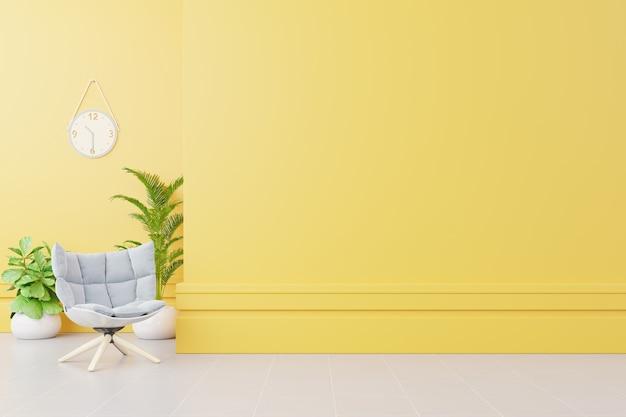 Wnętrze salonu z tkaniny fotel, lampa, książki i rośliny na pusty żółty mur Premium Zdjęcia