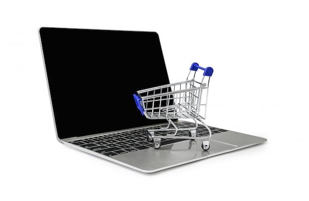 Wózek na klawiaturze laptopa na białym tle ze ścieżką przycinającą Premium Zdjęcia