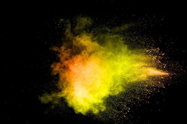 Wybuch kolorowego proszku pigmentowego. żywe cząsteczki pyłu Premium Zdjęcia