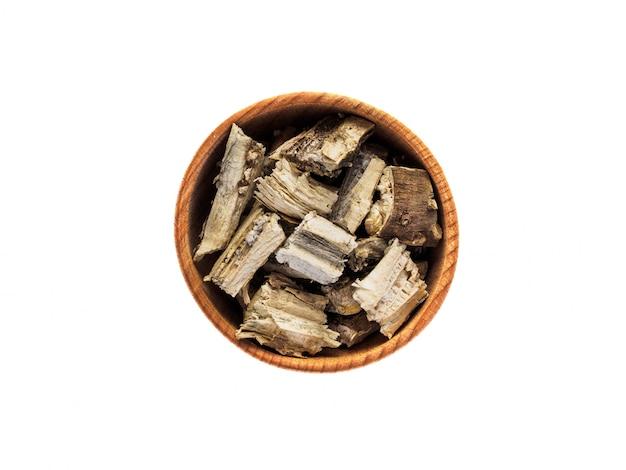 Wysuszyć Korzeń Słonecznika W Drewnianej Filiżance Na Białym Stole Premium Zdjęcia