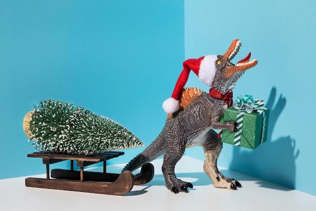 Zabawka Tyrannosaurus Rex Z Prezentem Premium Zdjęcia