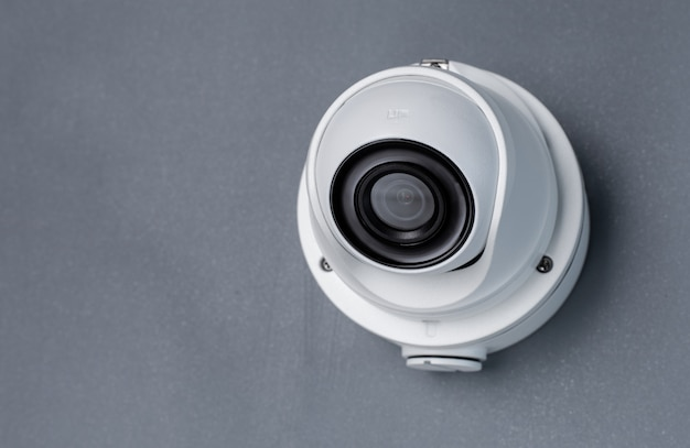 Zabezpieczenia Wideo Kamery Cctv Na Szarej ścianie. Skopiuj Miejsce Premium Zdjęcia
