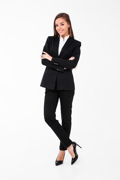 Zadziwiająca Rozochocona Biznesowej Kobiety Pozycja Z Rękami Krzyżować Darmowe Zdjęcia