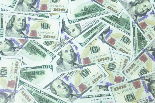 Zamknij zawartość biznesową banknotów 100 dolarów. Premium Zdjęcia