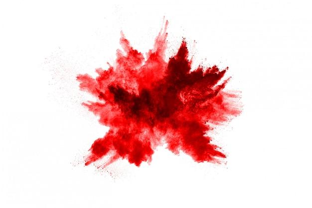 Zamrozić Ruch Czerwonego Proszku Eksplodującego, Na Białym Tle Premium Zdjęcia