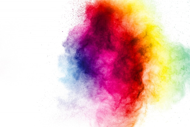 Zamrozić ruch eksplozji w kolorze proszku na białym tle. Premium Zdjęcia