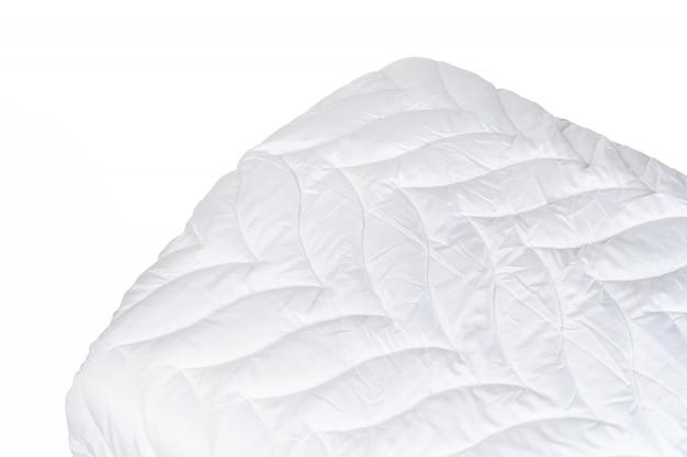 Zamyka up nowa koc odizolowywająca na białym tle Premium Zdjęcia