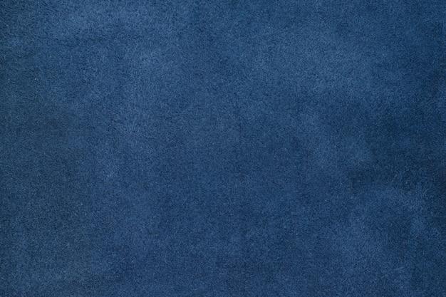 Zamyka w górę błękitnego koloru tekstury zmiętego rzemiennego tła Premium Zdjęcia